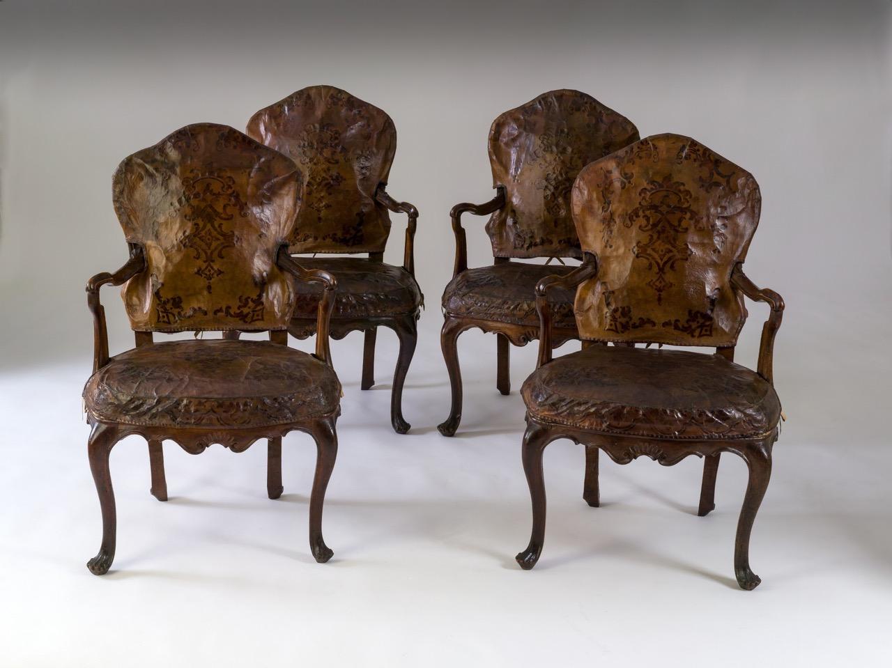 Four walnut wood armchairs