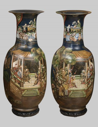 A pair of large painted terracotta vases